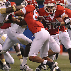 Dec 19, 2009; St. Petersburg, Fla., USA; Rutgers running back Joe Martinek (38) squeezes past wide receiver Marcus Cooper's (84) block during NCAA Football action in Rutgers' 45-24 victory over Central Florida in the St. Petersburg Bowl at Tropicana Field.