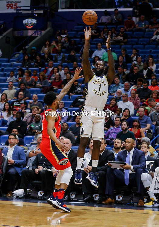 Mar 21, 2018; New Orleans, LA, USA; Indiana Pacers guard Lance Stephenson (1) shoots over New Orleans Pelicans guard Larry Drew II (1) during the first quarter at the Smoothie King Center. Mandatory Credit: Derick E. Hingle-USA TODAY Sports