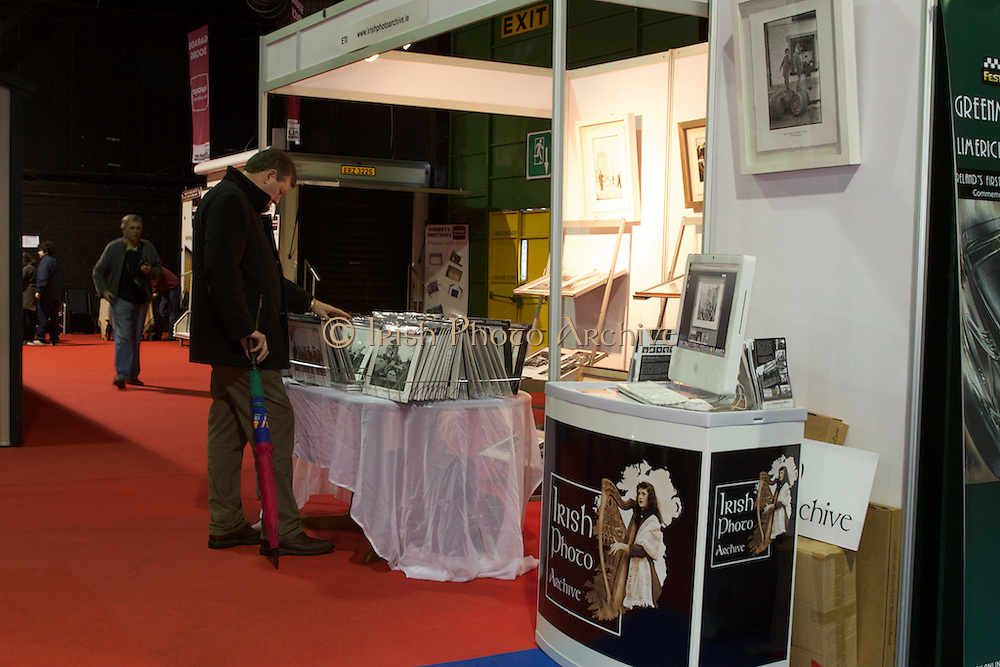 RIAC Classic Car Show 2013, RDS, Irish Photo Archive stand. Lensmen Press and Public Relations Photographic Agency was set up in 1952. The sixty years of Irish history captured there includes many fascinating images of key events: Rolling Stones, The Beatles, Princess Grace, Muhammad Ali and John F. Kennedy all visited, many Presidents were inaugurated and many Football and Hurling finals were won and lost. Irish, Photo, Archive.