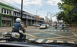 Image shows outriders from the Philippine National Police (PNP) escorting members of 77 Brigade on Exercise Civil Bridge 15A after a meeting at the PNP offices. <br /> <br /> Troops from 77 Bde today visited Philippine National Police offices &amp; The Rescue Emergency Disaster Training Facility, City of Pasig in Manila to discuss their earthquake contingency plans.<br /> 24/04/2015<br /> <br /> Credit should read: Cpl Mark Larner RY<br /> <br /> Exercise Civil Bridge is being conducted by elements of 77 Brigade &ndash; a specialist British military unit that is working alongside the government and disaster relief organisations as part of an annual overseas training exercise. <br /> <br /> Their mission during the two-week deployment will be to look at examples of the existing Philippine earthquake contingency response plans and, working with Philippine colleagues, make suggestions that will help save lives by enhancing the country&rsquo;s ability to respond to an earthquake in an urban setting.