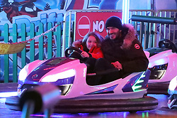 EXCLUSIVE: **NO WEB UNTIL 10.01 GMT 30th Nov** David Beckham and daughter Harper, seven, enjoy hot dogs and a whizz around the dodgems as they enjoy a festive family day at Winter Wonderland. 28 Nov 2018 Pictured: David Beckham with children Cruz, Romeo and Harper. Photo credit: MEGA TheMegaAgency.com +1 888 505 6342