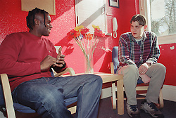 Keyworking session between support worker and resident of Young Persons' Resettlement hostel,