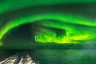 Auroral curtains from the deck of the m/s Nordlys on October 25, 2017, looking northeast toward the Big Dipper at centre. Arcturus is setting at left.