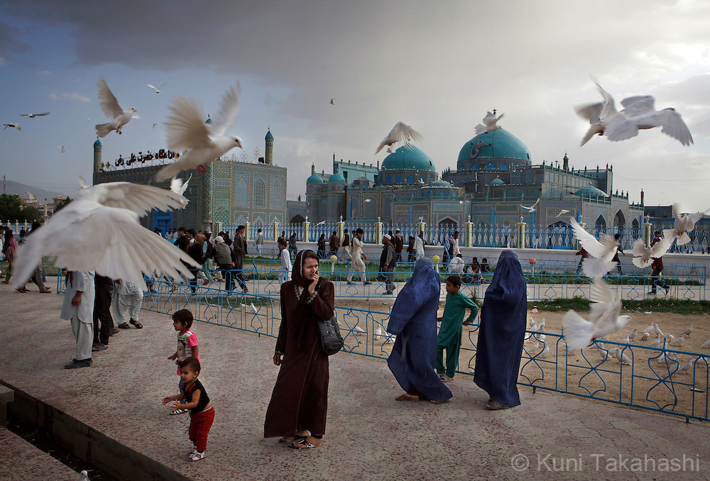( Mazar-i-Sharif, Afghanistan - May 11, 2012).Families visit Shrine of Hazrat Ali or the Blue Mosque is seen in background in Mazar-i-Sharif in Afghanistan on May 11, 2012. The historical mosque attracts thousands of pilgrims each year. .(Photo by Kuni Takahashi)