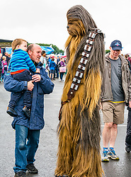 Pictured: Scotland's National Airshow, East Fortune, East Lothian, Scotland, United Kingdom, 27 July 2019 . A packed programme of aircraft old and new planned to take to the skies for the aerial display was marred by poor weather at airfields around the country which meant that many of the promised flights were unable to perform. Chewbacca makes an appearance to entertain the crowd. <br /> Sally Anderson | EdinburghElitemedia.co.uk