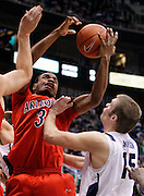 Arizona guard Kevin Parrom (3) attempts to grab a rebound as BYU center James Anderson (15) defends during the second half of an NCAA college basketball game, Saturday Dec. 11, 2010 in Salt Lake City. BYU defeated Arizona 87-65.  (AP Photo/Colin E Braley)