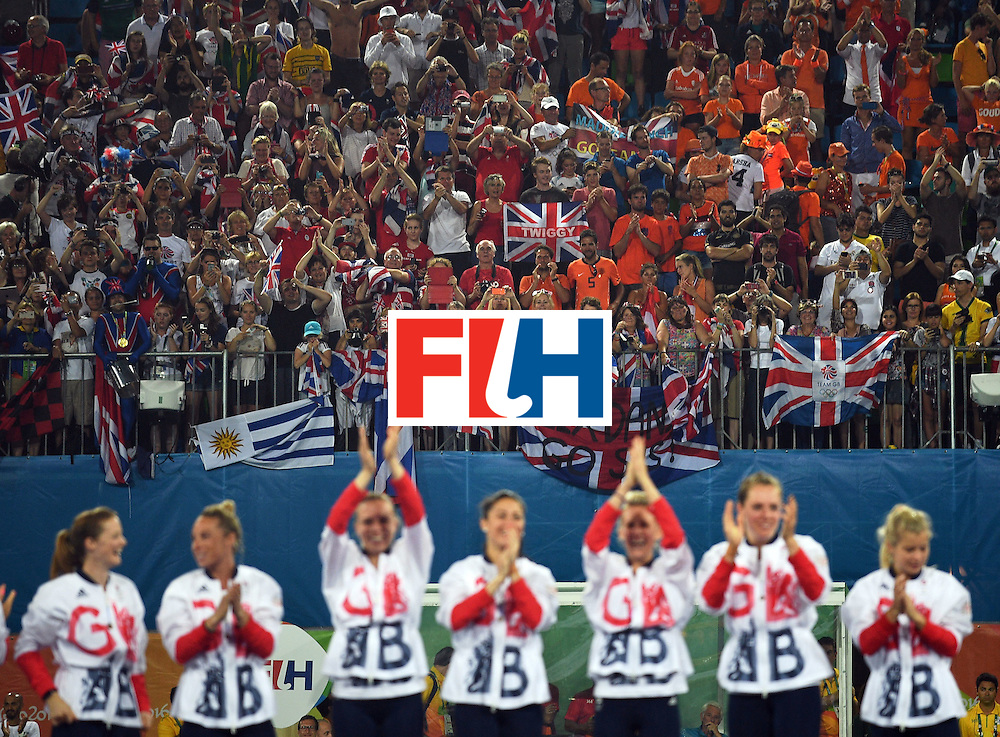 Britain's gold medallists celebrate during the women's field hockey medals ceremony of the Rio 2016 Olympics Games at the Olympic Hockey Centre in Rio de Janeiro on August 19, 2016. / AFP / MANAN VATSYAYANA        (Photo credit should read MANAN VATSYAYANA/AFP/Getty Images)