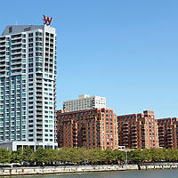 The Hoboken, New Jersey waterfront as viewed from the park on Pier A. The white W Hotel is visible with condominium buildings to the left and right. Hoboken was once a transportation and warehouse hub but has been gentrified over the last 30 years to be an upscale community across the Hudson