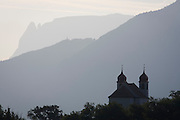 Remote chapel beneath Dolomites mountains, south-west of Bolzano, South Tyrol northern Italy.