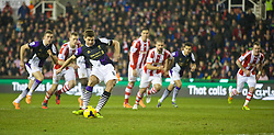 STOKE-ON-TRENT, ENGLAND - Sunday, January 12, 2014: Liverpool's captain Steven Gerrard scores the third goal against Stoke City from the penalty spot during the Premiership match at the Britannia Stadium. (Pic by David Rawcliffe/Propaganda)
