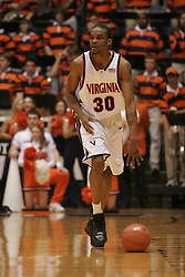 Adrian Joseph (30) dribbles the ball up court against Clemson.  Joseph lead the 'Hoos with 19 points as UVA beat the TIgers 64-58.