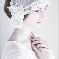 Close up of young girl with lace headdress