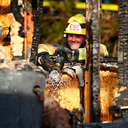 February 5, 2012 ? A firefighters looks into the room holding the bodies of Josh Powell and his two young sons Charlie and Braden after Powell burned down the house, killing his two young sons, in unincorporated Pierce County. Powell had been a person of interest in the disappearance of his wife, Susan Cox Powell in Utah.