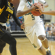 UNCW's Shatia Cole drives around Towson's Dominique Johnson Sunday January 25, 2015 at Trask Coliseum. (Jason A. Frizzelle)