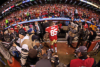 12 January 2013: Tight end (85) Vernon Davis of the San Francisco 49ers walks off the field after defeating the Green Bay Packers 45-31in an NFL Divisional Playoff Game at Candlestick Park in San Francisco, CA.