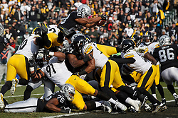OAKLAND, CA - DECEMBER 09: Running back Doug Martin #28 of the Oakland Raiders dives for a touchdown  against the Pittsburgh Steelers during the first quarter at the Oakland Coliseum on December 9, 2018 in Oakland, California. The Oakland Raiders defeated the Pittsburgh Steelers 24-21. (Photo by Jason O. Watson/Getty Images) *** Local Caption *** Doug Martin