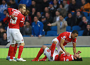 Charlton Athletic striker Reza Ghoochannejhad is mobbed after scoring the second goal for Charlton during the Sky Bet Championship match between Brighton and Hove Albion and Charlton Athletic at the American Express Community Stadium, Brighton and Hove, England on 5 December 2015. Photo by Bennett Dean.