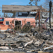 A home still smolders Friday, Oct. 12, 2018 in Mexico Beach after it was burnt to the ground. Residents of the small beach town of Mexico Beach began to make their way back to their homes some for the first time after Hurricane Michael made landfall Wednesday.