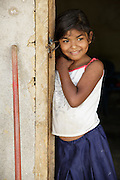A girl stands in the doorway of her home in Coyolito, Honduras on Thursday April 25, 2013.