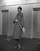 27/09/1960<br /> 09/27/1960<br /> 27 September 1960<br /> Fashions at Arnotts, black and white womens coat for Janus Advertising.