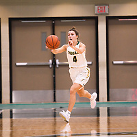 3rd year guard Avery Pearce (4) of the Regina Cougars during the Women's Basketball pre-season game on October 14 at Centre for Kinesiology, Health and Sport. Credit: Arthur Ward/Arthur Images