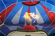 Ken Kus fills his balloon, Diamond Girl, with hot air before taking off at the Thurston Classic Hot Air Balloon Festival in Meadville, PA. Ten minutes after Kus took off, passenger Matt Kinzig proposed to his girlfriend Jennifer Robinson who was also flying with them.