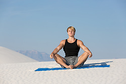 man meditating in the desert