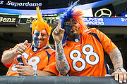NEW ORLEANS, LA - NOVEMBER 13:  Fans of the Denver Broncos celebrate after a touchdown during the first half of a game against the New Orleans Saints at Mercedes-Benz Superdome on November 13, 2016 in New Orleans, Louisiana.  (Photo by Wesley Hitt/Getty Images) *** Local Caption ***