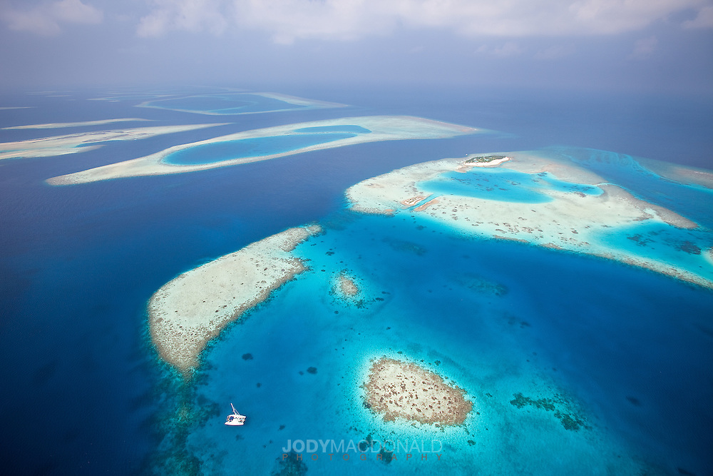 The Maldives stretch on like this for nearly 200 miles.  One reef atoll surrounded by deep water after another.  To get this shot we used a paragliding winch to tow up 3,000 feet, where I released and flew back down to the beach