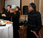 Ohio University Professor Emerita of African American Studies Francine Childs, right, enjoys the music at the All Black Affair at Baker University Center Ballroom at Ohio University on Friday, January 29, 2016. © Ohio University / Photo by Sonja Y. Foster