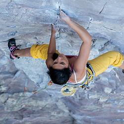 Samira Samimi Szymiec climbing Mardi Gras, 5.11b at Back of the Lake, Lake Louise, Alberta, Canada
