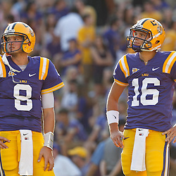 September 10, 2011; Baton Rouge, LA, USA;  LSU Tigers quarterbacks Zach Mettenberger (8) and Stephen Rivers (16) prior to kickoff of a game against the Northwestern State Demons at Tiger Stadium.  LSU defeated Northwestern State 49-3. Mandatory Credit: Derick E. Hingle-US PRESSWIRE