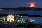 A full moon rises over Southport as seen from Five Islands, Georgetown. The town was throwing their annual holiday celebration, complete with tree lighting and fireworks, on this beautiful December night!