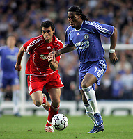 Photo: Paul Thomas.<br /> Chelsea v Liverpool. UEFA Champions League. Semi Final, 1st Leg. 25/04/2007.<br /> <br /> Didier Drogba (R) of Chelsea gets past Alvaro Arbeloa.