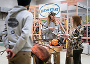 Operation Fresh Start student Xavier Asetamy provides a demonstration of woodland conservation technique during the grand opening ceremony for Operation Fresh Start on Milwaukee Street in Madison, WI on Thursday, April 11, 2019.