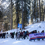 The third and final day of the Strike WEF march on Davos, 21th of January 2020, Switzerland. The march on the last day started in Klosters where hundreds of activists took the mountain path to Davos.  The authorities would not allow the marchers to walk o the road to Davos so many opted to walk the ten km on the ardous and snowy hiking trail.  The march is a three day protest against the World Economic Forum meeting in Davos. The activists want climate justice and think that The WEF is for the world's richest and political elite only.