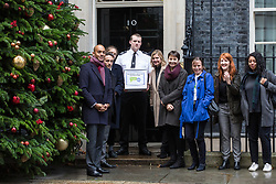 London, UK. 3rd December, 2018. A group including People's Vote spokesman Chuka Umunna MP, Caroline Lucas MP, Justine Greening MP, co-founder of Our Future Our Choice Lara Spirit and editor of the Independent Christian Broughton deliver a Final Say petition signed by over a million people to 10 Downing Street to be presented to Prime Minister Theresa May following her return from the G20 summit in Buenos Aires.