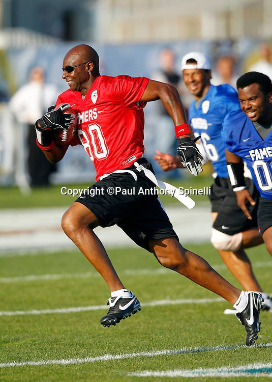 Former San Francisco 49ers wide receiver Jerry Rice (80) of the Gamers team runs the ball while playing flag football in the EA Sports Madden NFL 11 Launch celebrity and NFL player flag football game held at Malibu Bluffs State Park on July 22, 2010 in Malibu, California. (©Paul Anthony Spinelli)