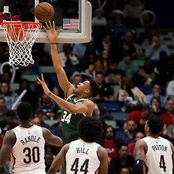 Mar 12, 2019; New Orleans, LA, USA; Milwaukee Bucks forward Giannis Antetokounmpo (34) shoots over New Orleans Pelicans center Julius Randle (30) and forward Solomon Hill (44) and guard Elfrid Payton (4) during the second quarter at the Smoothie King Center. Mandatory Credit: Derick E. Hingle-USA TODAY Sports