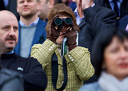 LIVERPOOL, ENGLAND - Thursday, April 6, 2017: A race goer uses binoculars, during The Opening Day on Day One of the Aintree Grand National Festival 2017 at Aintree Racecourse. (Pic by David Rawcliffe/Propaganda)