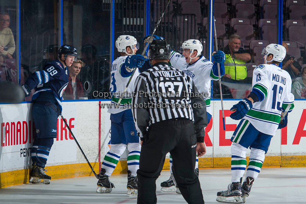 PENTICTON, CANADA - SEPTEMBER 8: Johah Gadjovic #43 and Kole Lind #78 of Vancouver Canucks celebrate a first period goal against the Winnipeg Jets on September 8, 2017 at the South Okanagan Event Centre in Penticton, British Columbia, Canada.  (Photo by Marissa Baecker/Shoot the Breeze)  *** Local Caption ***