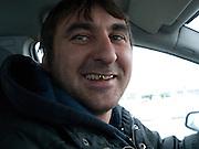 Nowosibirsk/Russische Foederation, RUS, 19.11.07: Taxifahrer mit Goldzahn in der sibirischen Hauptstadt Nowosibirsk. <br /> <br /> Novosibirsk/Russian Federation, RUS, 19.11.07: Cab driver with golden teeth working in Novosibirsk the capital city of Siberia.