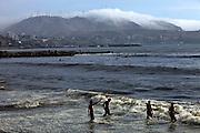 Bathers enjoy the beginning of the summer in the misty coastline of Lima, Peru, Thursday, Dec. 23, 2010.(Photo Dado Galdieri)