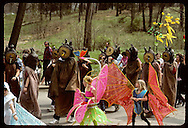 Kids march in Earth Day parade in insect costumes beside leech kazoo band; Forest Park-St Louis Missouri