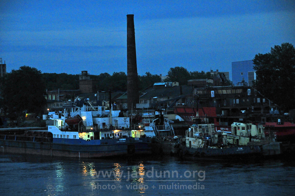 Serious work vessels line the banks of the Neva River as it widens east of St. Petersburg, Russia.