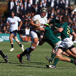 DURBAN, SOUTH AFRICA - JUNE 06: Reyno Potgieter of (Monnas) on attack as he is tackled by Marco Palvie of Glenwood during the 2015 Mutual & Federal Premier Interschools match between Glenwood High School and Monnas at Glenwood High School on June 06, 2015 in Durban, South Africa. (Photo by Steve Haag/Gallo Images)