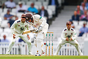 Wicket! Gareth Batty of Surrey bowled out lbw by Matt Milnes of Kent during the Specsavers County Champ Div 1 match between Surrey County Cricket Club and Kent County Cricket Club at the Kia Oval, Kennington, United Kingdom on 10 July 2019.