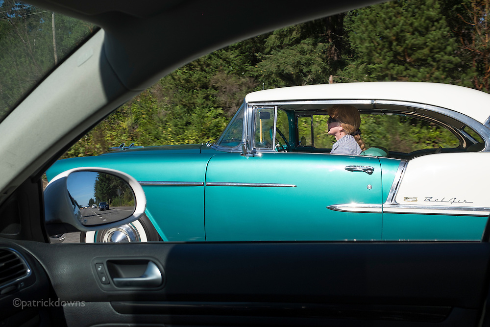 Woman driving a '55 Chevy BelAir in Gig Harbor, WA.