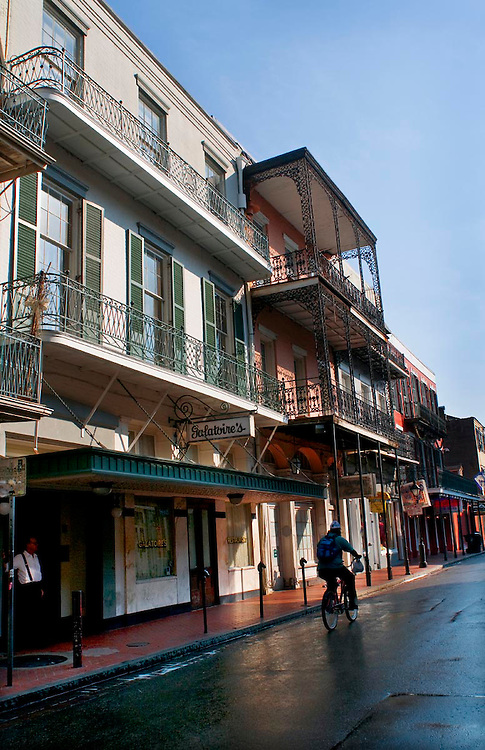 A bicyclist rides by Galatoire's Restaurant located at 209 Bourbon St. in the French Quarter in New Orleans, LA.