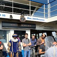 Nederland, Amsterdam , 3 juli 2014.<br /> Zwarte Piet aan boord van het pontje dat vanuit het Centraal Station over het IJ naar Noord vaart.<br /> De Gemeente Amsterdam moet het besluit over de vergunning voor de Sinterklaasintocht van vorig jaar herzien, omdat de belangen van tegenstanders van Zwarte Piet niet goed afgewogen zijn.<br /> Foto:Jean-Pierre Jans